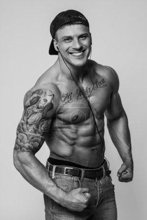 Black and white portrait of shirtless bodybuilder