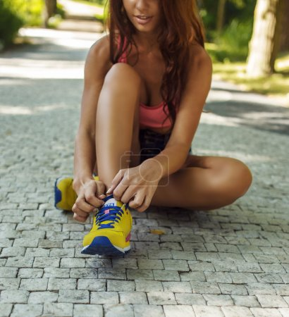 Slim female in yellow shoes.