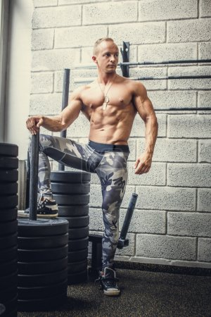 shirtless man in military pants
