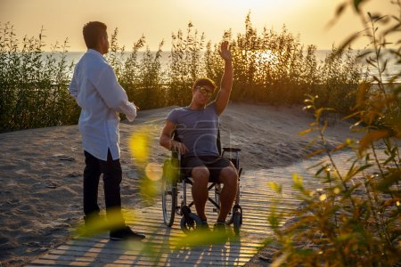 Young man in wheelchair and his doctor.