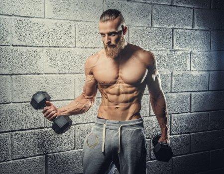 Strong muscular man with beard.