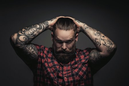 Man with beard and tattoes.