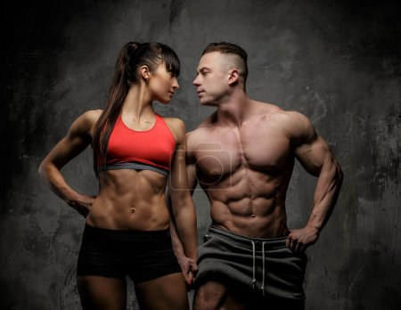 Muscular man and fitness woman.