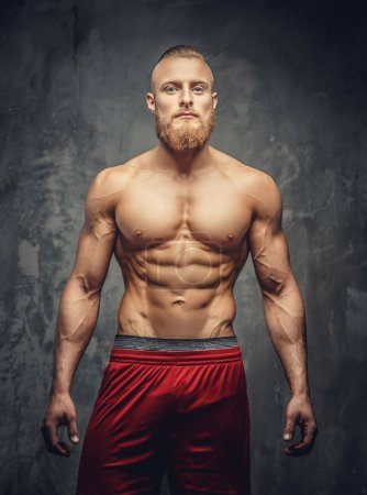 shirtless muscular bearded man in red