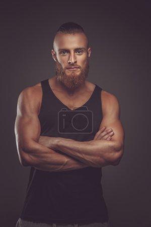 Athletic bearded man in black t shirt.