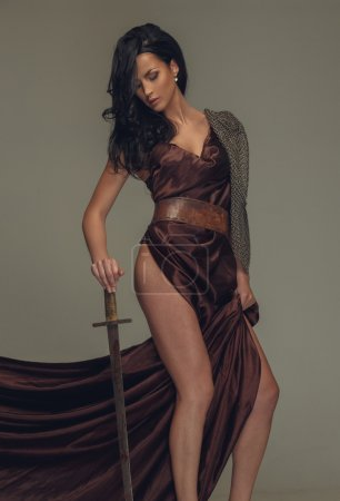 Full body picture of brunette woman with sword....