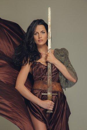 Beautiful brunette woman in ancient dress.