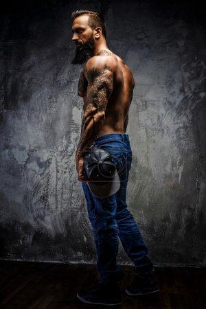 Full body portrait of muscular man.