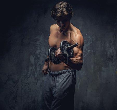 Shirtless bodybuilder doing exercises.