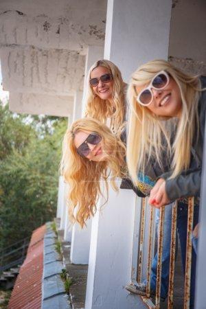 Three glamorous blond women