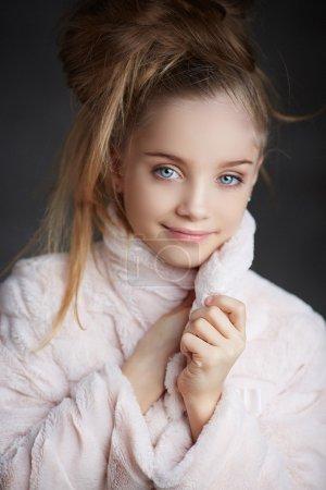 Portrait of cute blond girl.