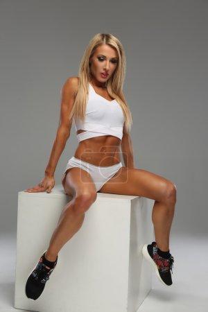 Sexy blond woman in white underwear.
