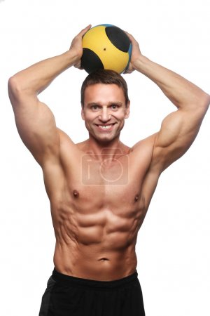 bodybuilder posing with valleyball.