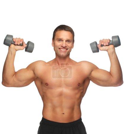 Muscular man doing exercises
