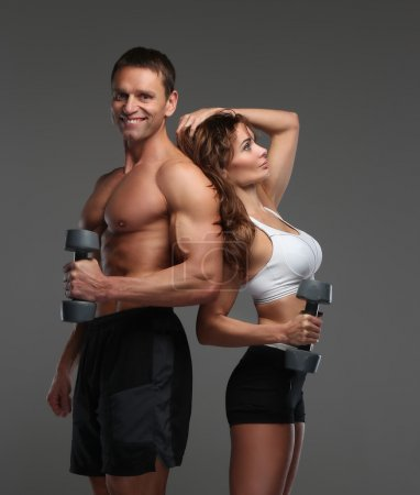 Muscular fitness man and a woman.