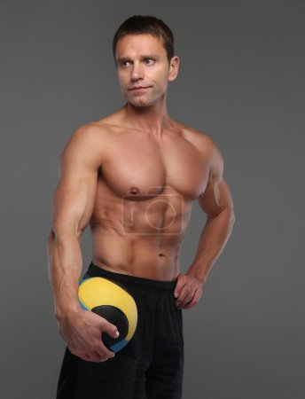 Shirtless muscular volleyball