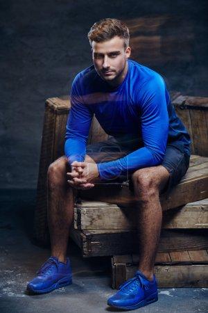 Young man in blue sportswear.