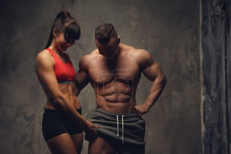 Guy and a woman in sportswear.