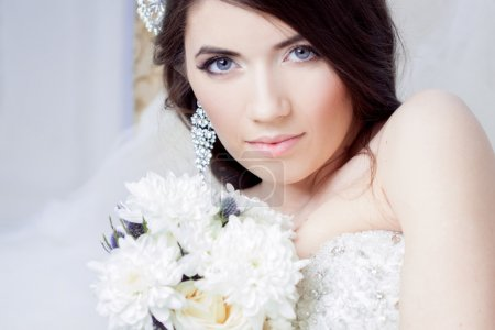 Happy bride laughing, girl with a bouquet of flowers. Wedding decoration