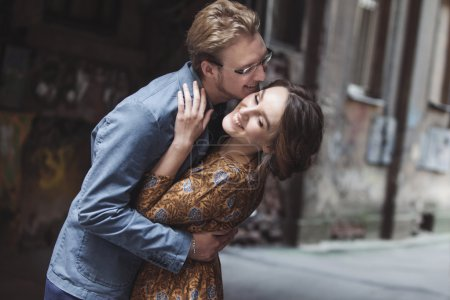 Photo for Man hugs a woman. The girl looks over the shoulder of a partner - Royalty Free Image