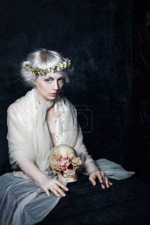 Photo for The girl in sorrow, beautiful sad girl with a wreath on his head - Royalty Free Image
