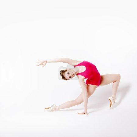 girl ballerina in a pink leotard