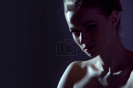 Low key image, portrait of a beautiful woman