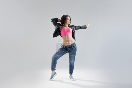 young woman hip hop dancer with white background