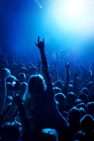 Grunge style photo, people hands raised up on musical concert