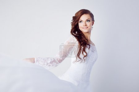Beautiful bride in wedding dress, white background, close up