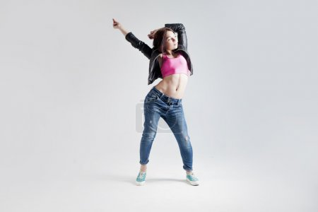 young woman hip hop dancer, in the Studio on a white background