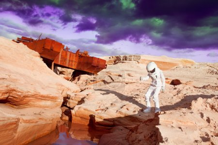 Photo for Futuristic astronaut on another planet, sandy red planet - Royalty Free Image