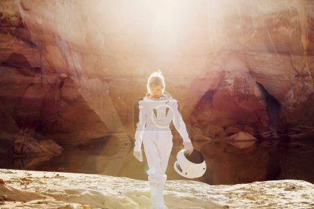 futuristic astronaut without a helmet in rays of another sun, image with the effect  toning