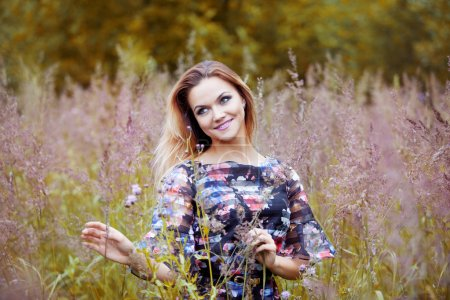 Beauty Girl Outdoors enjoying nature, beautiful girl in flower field