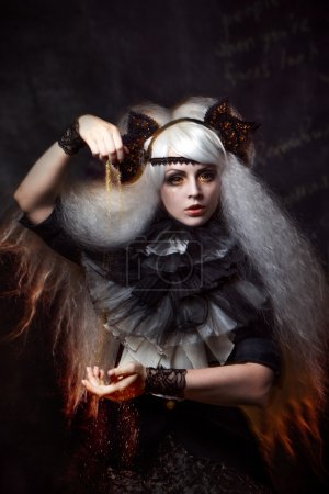 Photo for Girl in the image of a witch with a lush white hair - Royalty Free Image