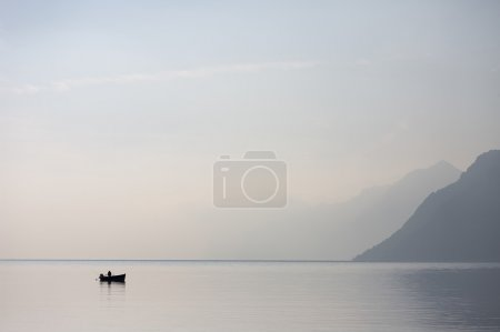 Lone Boat in the Lake Garda