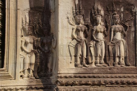 Apsara dancers decorate the interior courtyard wal...