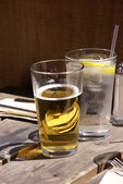 Glasses of beer and water