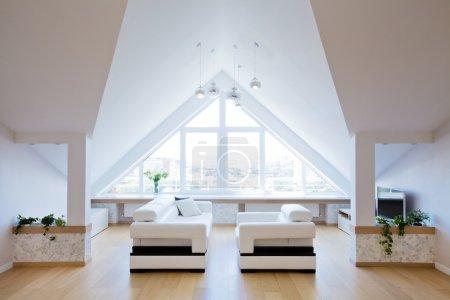 Modern interior light a large apartment in the att...