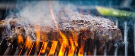 Delicious steak on grill