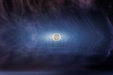 Moon in starry night sky