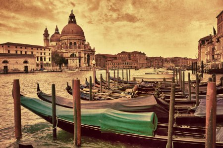 Photo pour Gondolas moored on Grand Canal opposite Santa Maria della Salute church in Venice, Italy. Filtered image, vintage effect applied - image libre de droit