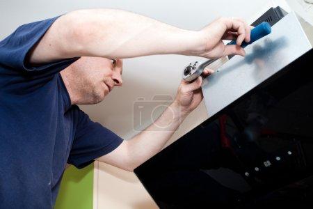 Craftsman kitchen carpenter at kitchen cabinet installation serv