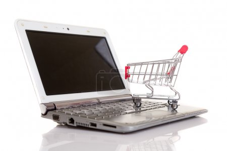 Shopping cart over a laptop