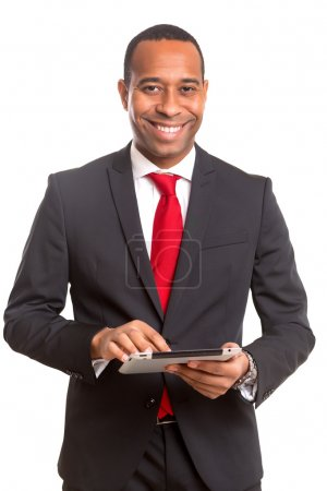 Photo for A young african business man working with a laptop - Royalty Free Image
