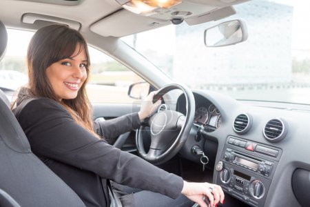 Business woman driving car