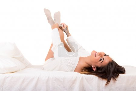 Photo for Beautiful young and beautiful woman relaxing in bed - Royalty Free Image
