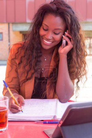 student african woman at the phone