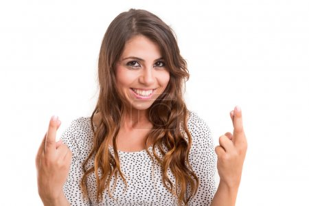 Photo pour Femme aux doigts croisés, isolée sur fond blanc - image libre de droit
