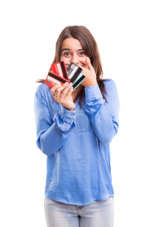 Happy woman holding credit cards